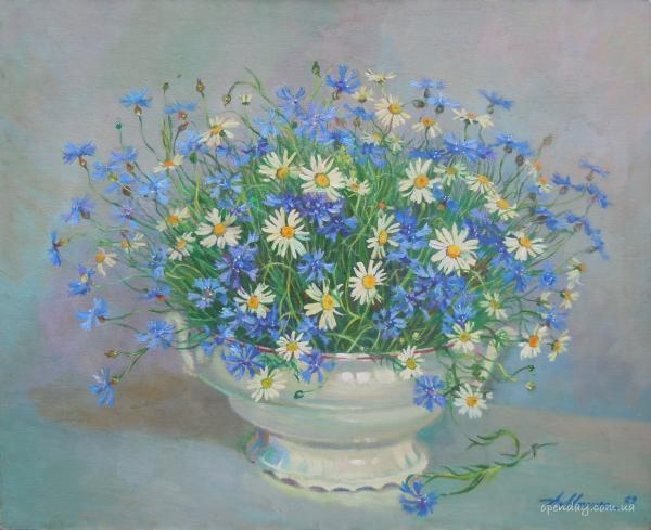 Daisies and cornflowers in a vase